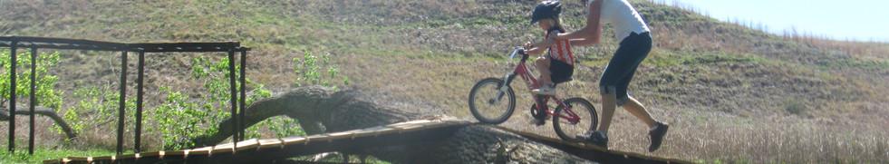 Family mountain biking. Learning to ride. Outdoor kids.