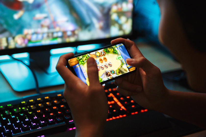 Portrait of teenage gamer boy playing vi
