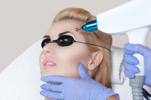 Laser tattoo removal on woman's eyebrows in a beauty salon.jpg