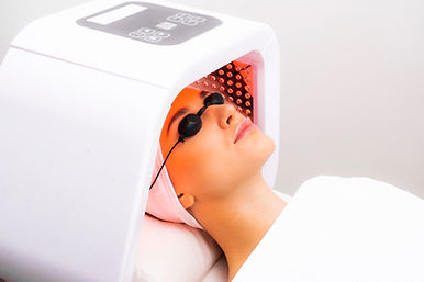 Express facial treatment with led therapy. Beautiful girl on a light therapy procedure. LE