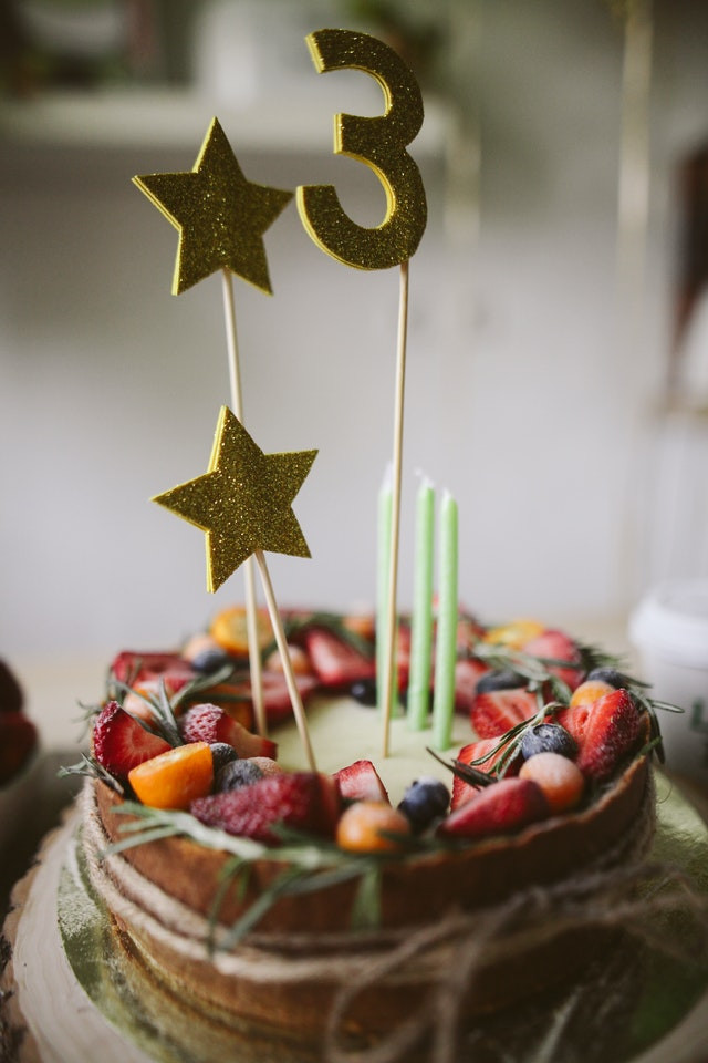 Birthday Cake with Berries Topped with Stars & the Number 3