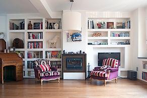 Ristrutturazioni parete attrezzata in cartongesso con libreria e camino