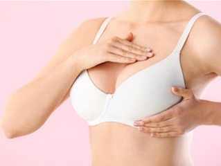GP demonstrates how to check breasts for signs of cancer