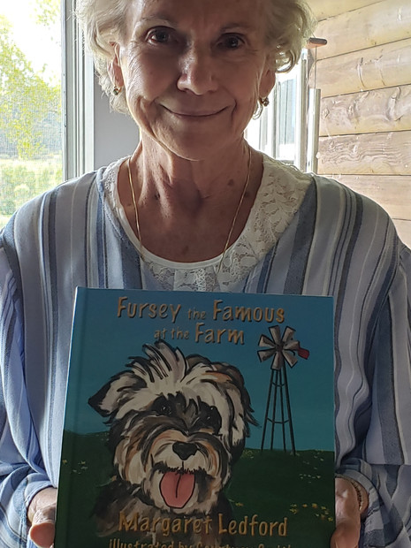 Margaret Ledford with her book, Fursey the Famous at the Farm