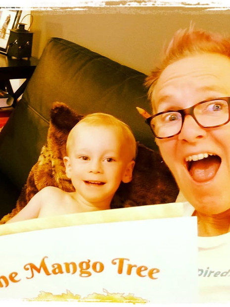 Joules and Taran-the-Wonderboy reading The Mango Tree