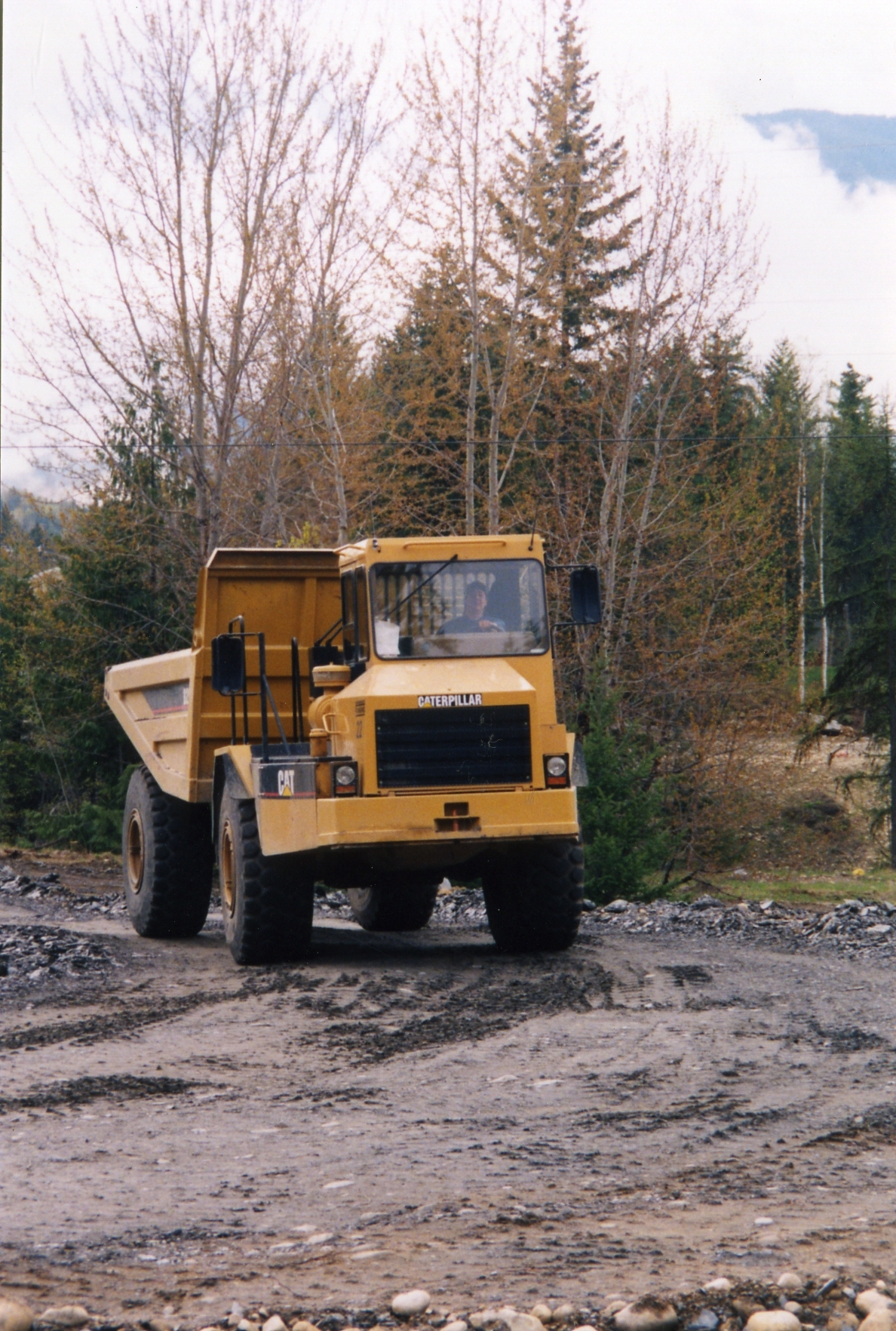 Shawn & the rock truck hard at work.jpg