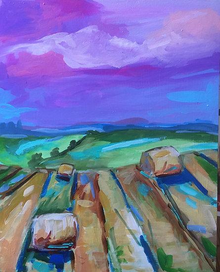 Round Bales Under a Purple Sky