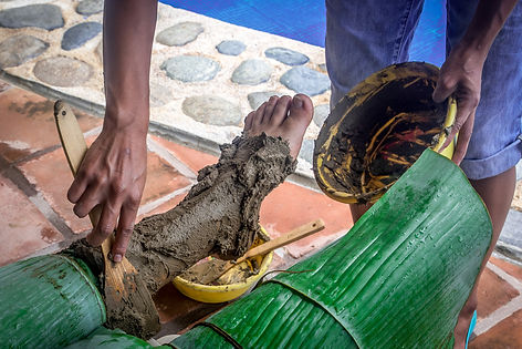 Clay is applied as a gout treatment, to the legs and feet, covered by banana leaves to keep the moisture inside the clay.