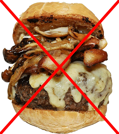 Photo showing an unhealthy greasy cheese hamburger, precisely the food that is causing high uric acid and gout.