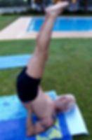 A gout patient performing yoga next to the swimming pool.