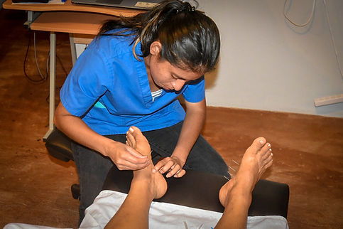 Master Tung Style Acupuncture of the feet of a Gout Patient