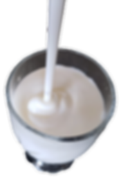Filling a glas with fresh yogurt