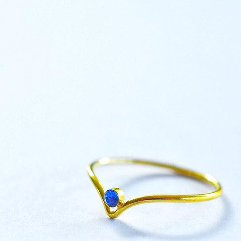 Fijne vergulde ring met blauw swarovski pareltje