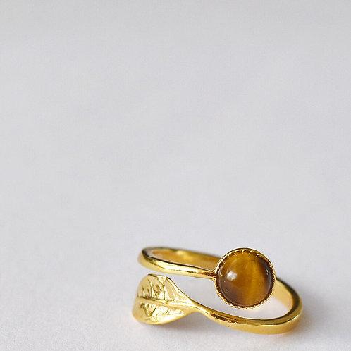 Verstelbare ring met blaadje en bruine edelsteen