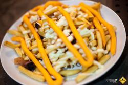 Deliciosa Porção de Fritas e Cheddar