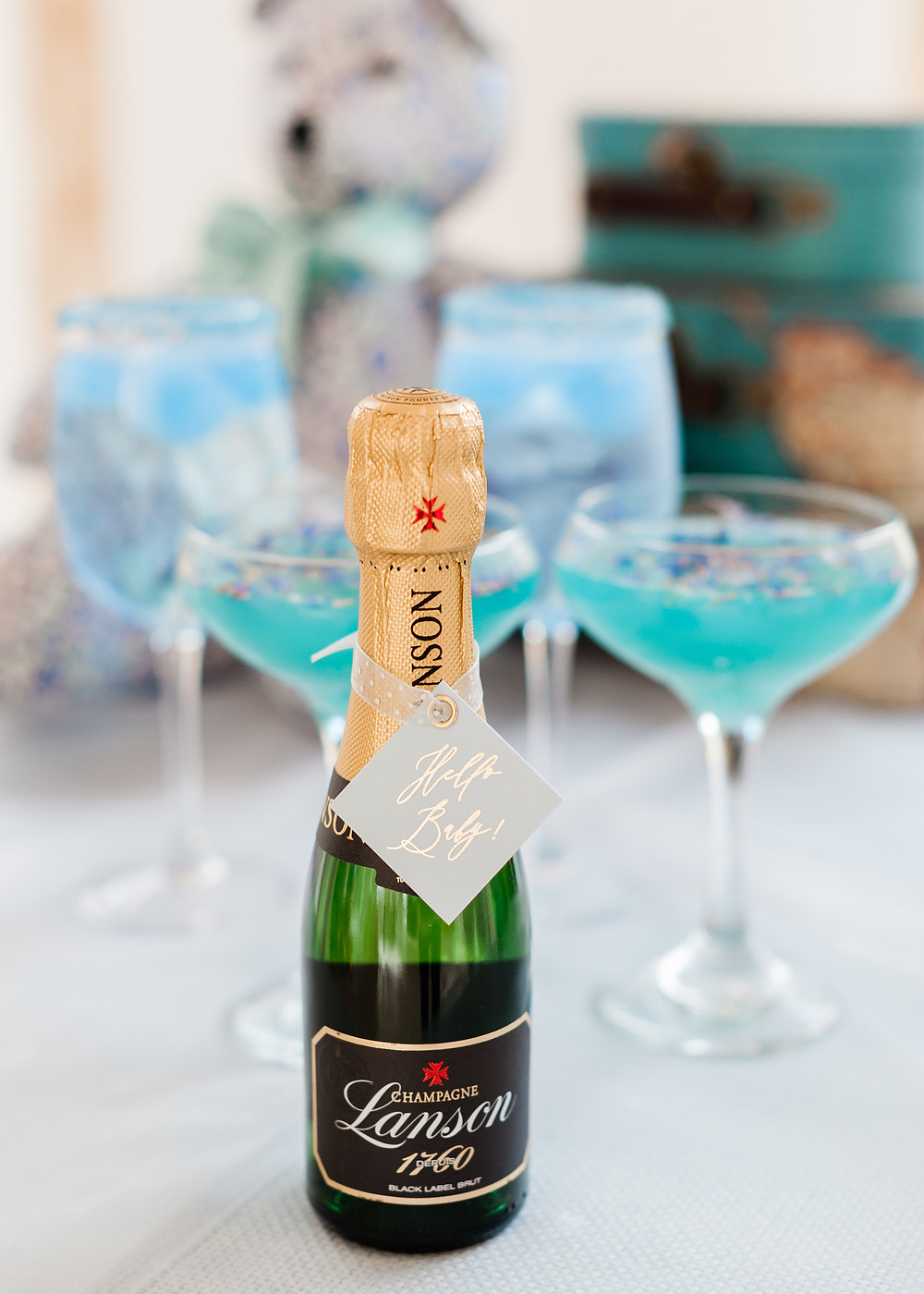 Baby shower blue cocktails and mini champagne