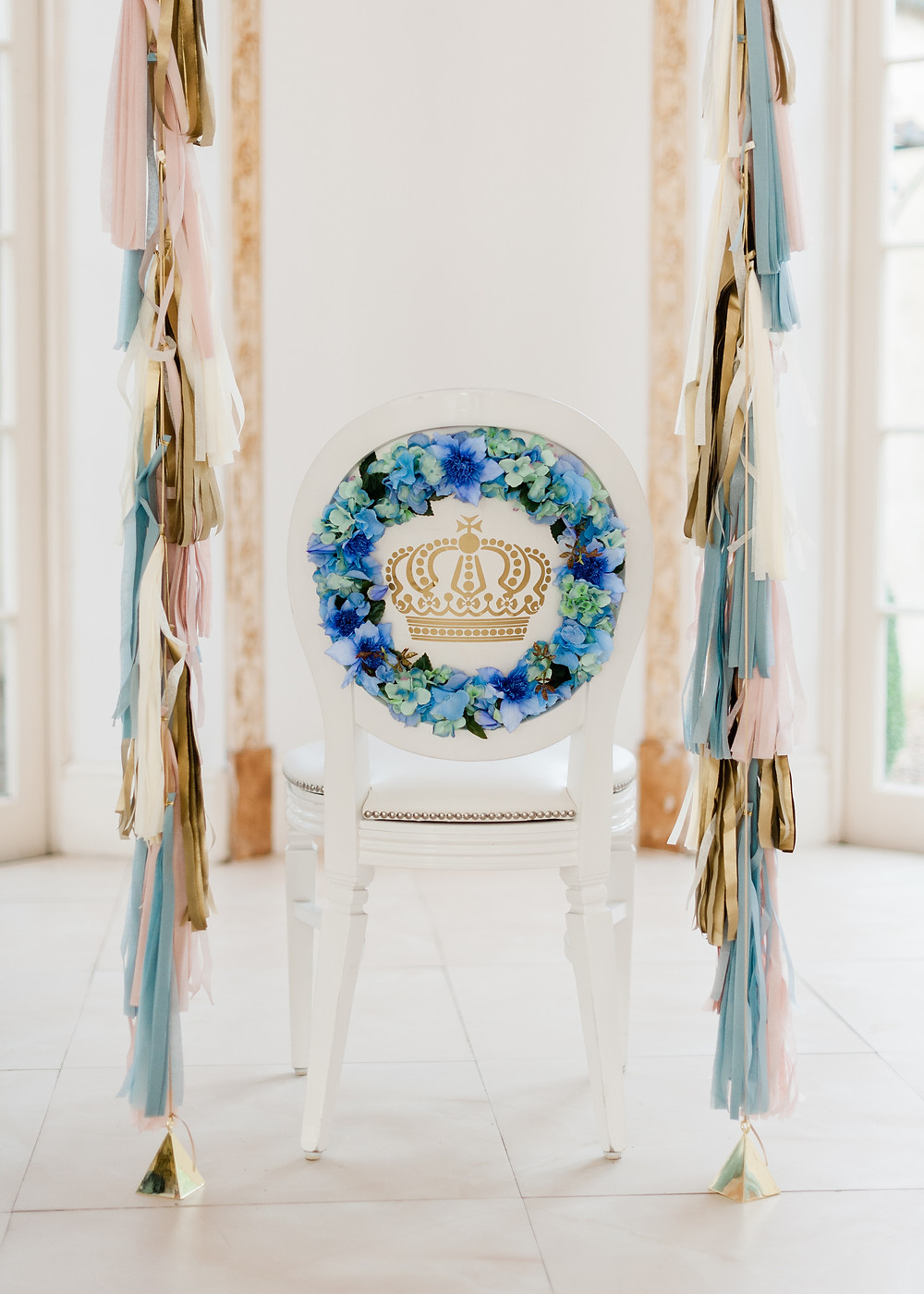 Blue bespoke chair back with gold monogram