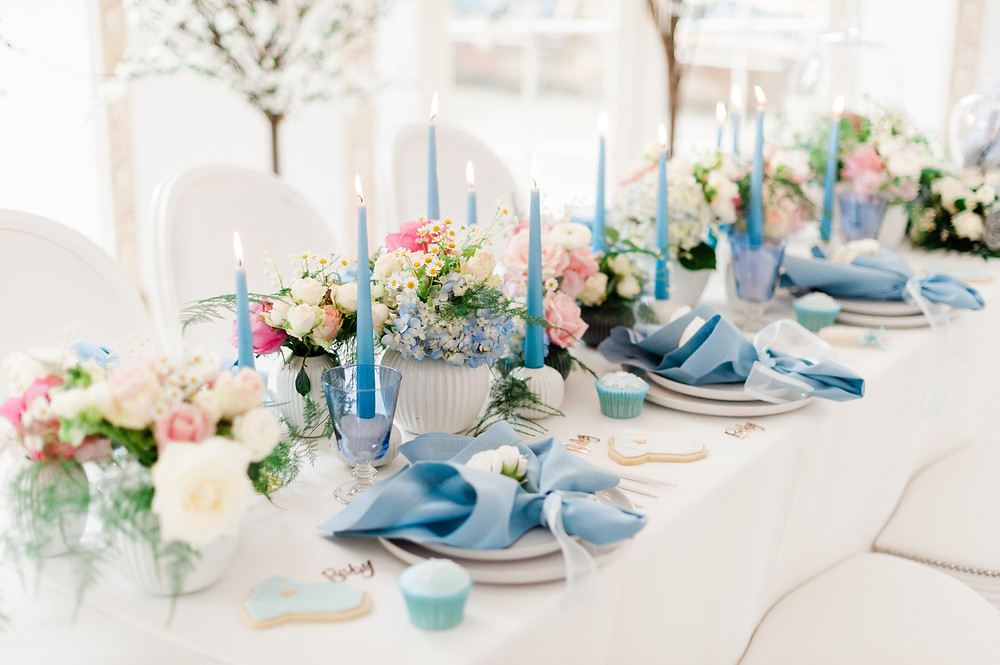 Pastel blue tablescape for a baby shower, blue table styling