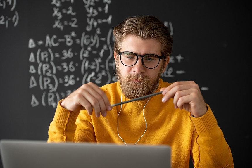 young-bearded-pensive-teacher-in-eyeglas
