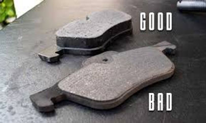 Brake pads worn vs new.jpg
