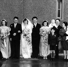 Mary & Tommy's wedding in 1953. On the right, my mum and dad are holding me and my twin sister. St Brendan's Church Yoker 17th february 1953. - Photographed supplied by Mary Tierney.