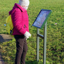 Helen reading a bit about the history of the Antonine Wall built by the Romans and runs through Goldenhill Park.  -  23rd January 2021