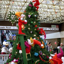 Christmas display in the shopping centre. Santa's little helpers. - 3rd December 1982
