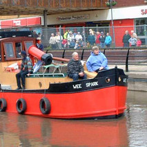 The Wee Spark, a mini version of the Vital Spark, sailing past the Clyde Shopping Centre.   -  8th June 2001