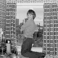 Helen's nephew, Jamie cleaning our windows for Bob-a-Job Week. - January 1979