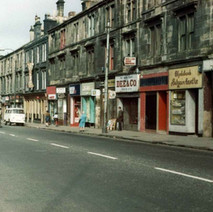 The Glasgow Road shops and tenements across from John Brown's shipyard. - Photo by Tommy Quinn.