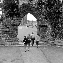 Tourists enjoying a walk through the grounds of the Cathedral of St Andrews. - Sunday 23rd July 1978