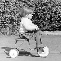 Jennifer speeding on her trike. - April 1981