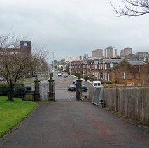Looking out the gates of Kilbowie Cemetery towards Montrose Street. - 24th February 2011