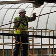 The specialists are preparing the bandstand for transporting to the new location. - Clydebank. 19th March 2010