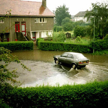The car sails away to safety. - Whitecrook, Clydebank. 5th July 1985.