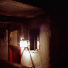 Gaslight in a close in Maryhill - 1978