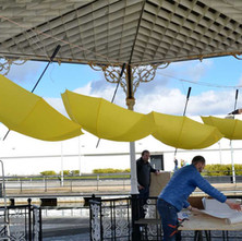 Yellow umbrellas at the bandstand. Phase one of the Clydebank Can Project. - 24th March 2018