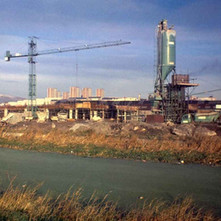 The green canal and the Clyde Shopping Centre under construction. The canal was that green, it looked like grass. - Clydebank 1978