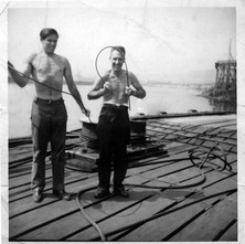 Tommy Tierney and mate bending steel rod in John Brown's. John Brown's Shipyard, Clydebank. - Photograph supplied by Mary Tierney.