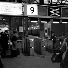 This is a photo of platform nine & ten in Central station Glasgow. As in Harry Potter, in between would be platform nine & three quarters and the little boy looks as if he is going for the Hogwarts Express. - 1979