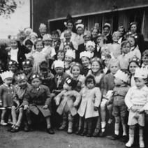Marion Fields sent me this 1953 Coronation Party photo. She is the girl in the front row, far right with the wee baby in front of her. Marion's younger brother is behind the wee one on the front row with the crown on.