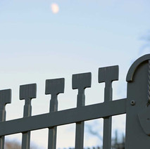 Detail of the steel fence that protects the stone fondation of the Antonine Wall in Goldenhill Park.  -  23rd January 2021