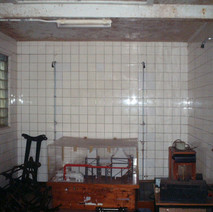 Showers in the Clydebank Baths in Bruce Street, filled with junk.  -  24th March 2002