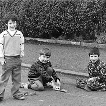 Boys playing in the street with their cars, before the days of Playstation 3 and X-Box. - March 9th 1981