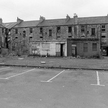 The tenements are in a sorry state. This is the car park behind Glasgow Road. The tenements in the photo are Hume Street. - Saturday 19th August 1978