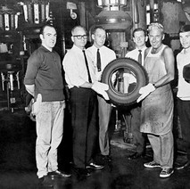 Tommy Tierney (the man with the tan) working in the Goodyear Tyre Factory. - Photographed supplied by Mary Tierney.