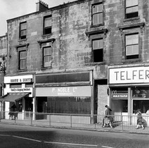 These shops, next to the ones getting demolished, are still open, but not for long by the look of things. - Saturday 3rd March 1979
