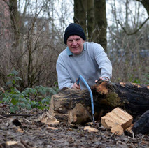 I came across this chap cutting up fallen trees for firewood. - 26th January 2013