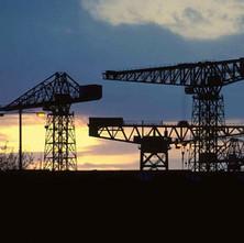 Clydebank Shipyard Cranes at sunset. Clydebank 1981