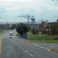 Looking down Kilbowie Road, the shipyard cranes towering over the town.  -  18th August 2001